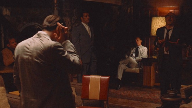Michael's meetings extend into the evening, with loyal allies like Rocco Lampone, Willi Cicci, and Tom Hagen around the room as Frankie Pentangeli rants about the Rosato brothers.