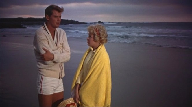 The pleasant crashing of the waves could be ominous as they provide the backdrop for Johnny and Molly plotting their scheme for escaping forced family fun time to share what would be an amorous date night.