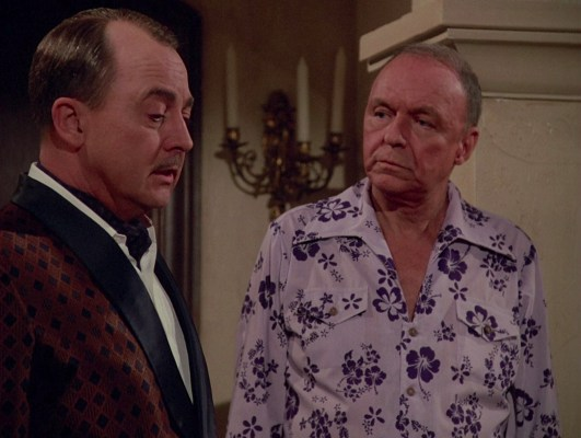 As the latest houseguest at Robin's Nest, Doheny is shown to his new quarters by the estate's proud majordomo Higgins (John Hillerman).