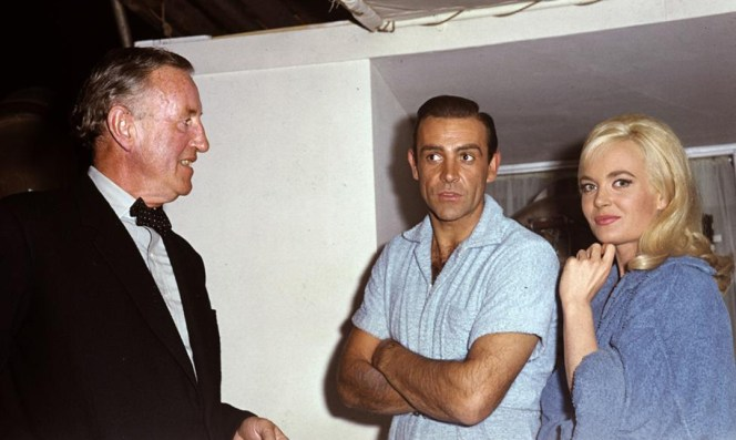 Ian Fleming joins Sean Connery and Shirley Eaton on the set of Goldfinger. The author who had penned 12 original Bond novels and 9 short stories lived to see the first two film adaptations of his most famous literary creation, though he would die one month before Goldfinger was released.