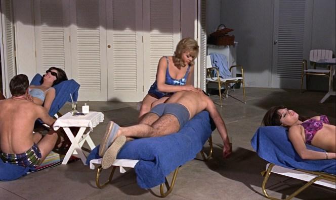 Bond enjoys some poolside R&R in Dink's hands.