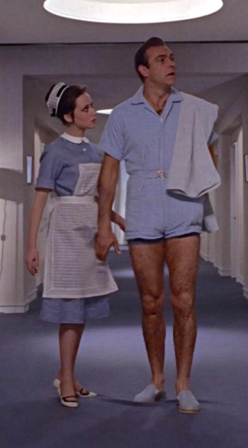 "Sean Connery as James Bond in Goldfinger (1964), ""convincing"" a maid (Janette Rowsell) to let him enter Goldfinger's room."