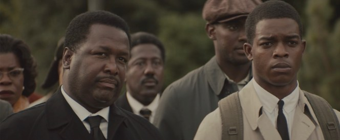 Hosea Williams (Wendell Pierce) and John Lewis approach the state troopers.