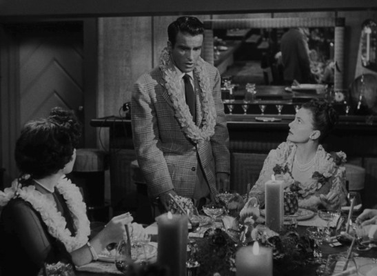 George gets an alarming phone call that requires him to surrender eventually not only his relationship with Angela but also that floral lei.