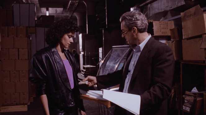 A leather-clad Karen consults with a suspicious Jimmy after Henry's arrest.