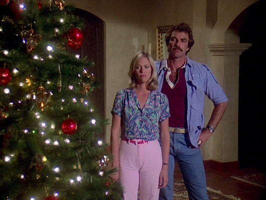 "Tom Selleck and Katherine Cannon in Magnum, P.I.'s first season Christmas-set episode ""Thank Heaven for Little Girls and Big Ones Too""."