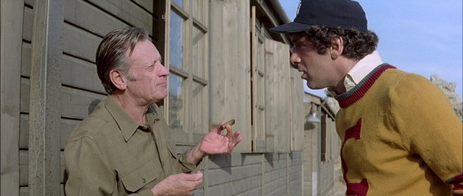 William Holden and Elliott Gould in Escape to Athena (1979)