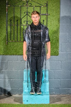Cameron Kelly in A PVC Mac, Woven Woolen Jumper by Jamie Russell, Jeans, Stylists Own @ West Coast Cooler FASHIONWEEK