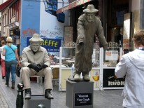 """Street performer(s)...I think the one on the right standing up isn't really a person..."