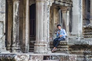 Man working at Angkor Wat