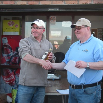 BAC Friendship Cup Corbet Lough 8 April 2017 Martin Dynes presents Aidan Donnelly with a prize for being the Armagh Club's top rod