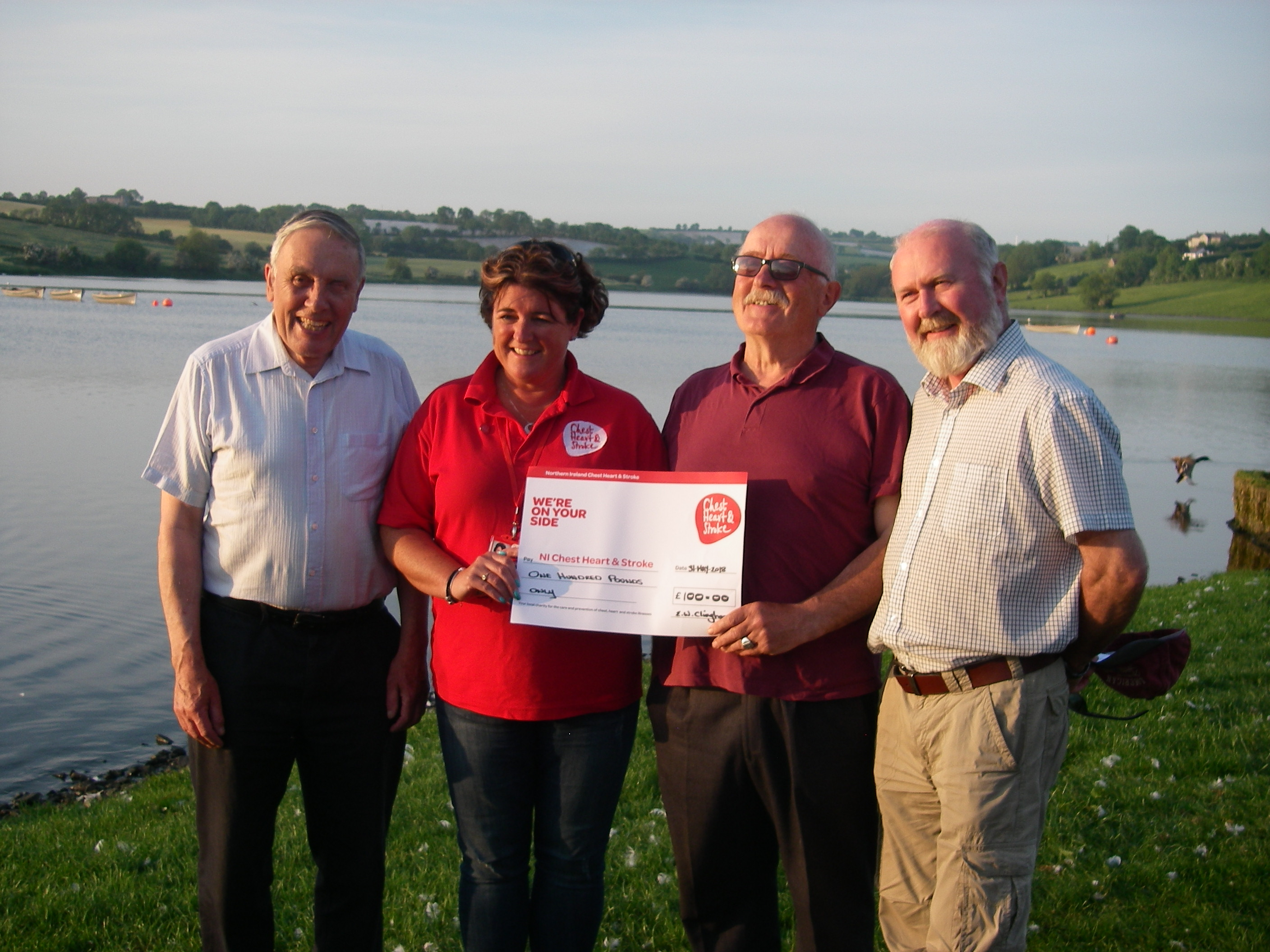 BAC Joe McCandless, President and Joe Curran Secretary watch on as Wilson Clinghan, representing the Club's competition anglers make a charity donation to Kim Colhoun, Chest, Heart and Stroke Association at Corbet Lough on 31 May 2018