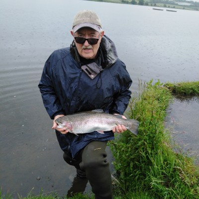 BAC - A 'studious' Wilson 'Skippy' Clinghan with a cracking Rainbow of 6lbs 10 ozs taken on the fly at Corbet Lough on Saturday 15 June 2019. Wilson sportingly returned this great fish.