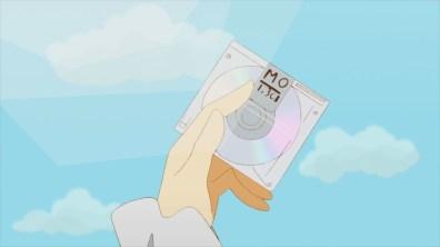 """Em baixo: Y com um CD de """"dados""""."""