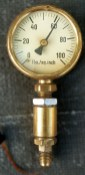 Completed brass gauge (note servo wire exiting at the bottom)