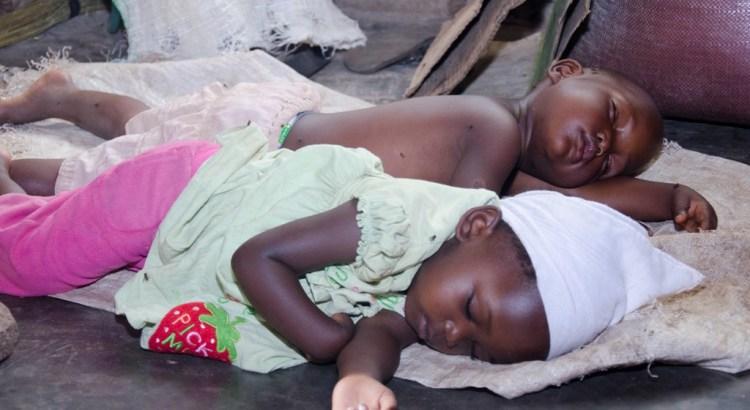 Baby Shaluwa and Baby Derick Sleeping on the Floor