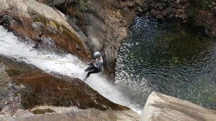 Lena on the second rappel at Seven and Half Cups ( Ezharakundu Falls)