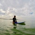 Vijay Nandani - on a surfboard waiting for a wave