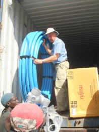 Rotarian volunteer, Bruce Lamford, assisting with equipment