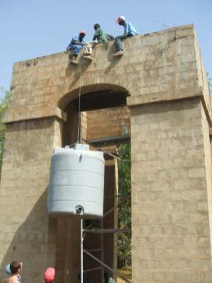 Lifting the new water tank into place