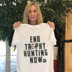 Angie Best holds up our Tee