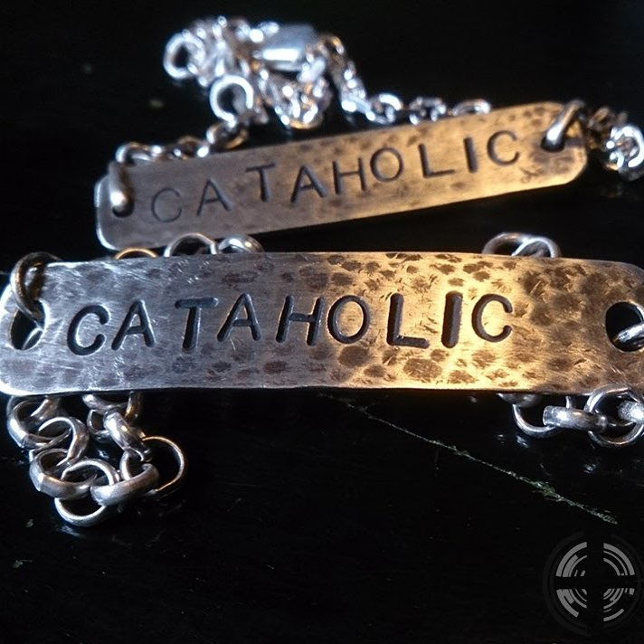 CATAHOLIC armband 700:-