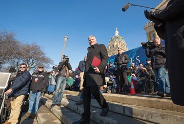 Franklin Graham walks down the steps at the Iowa Capitol.