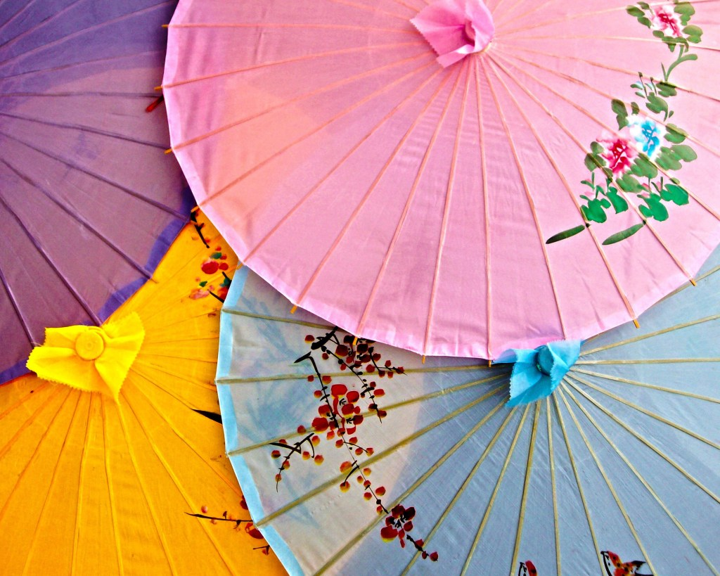 Pastel colors of oriental umbrellas layered and bleeding through each other