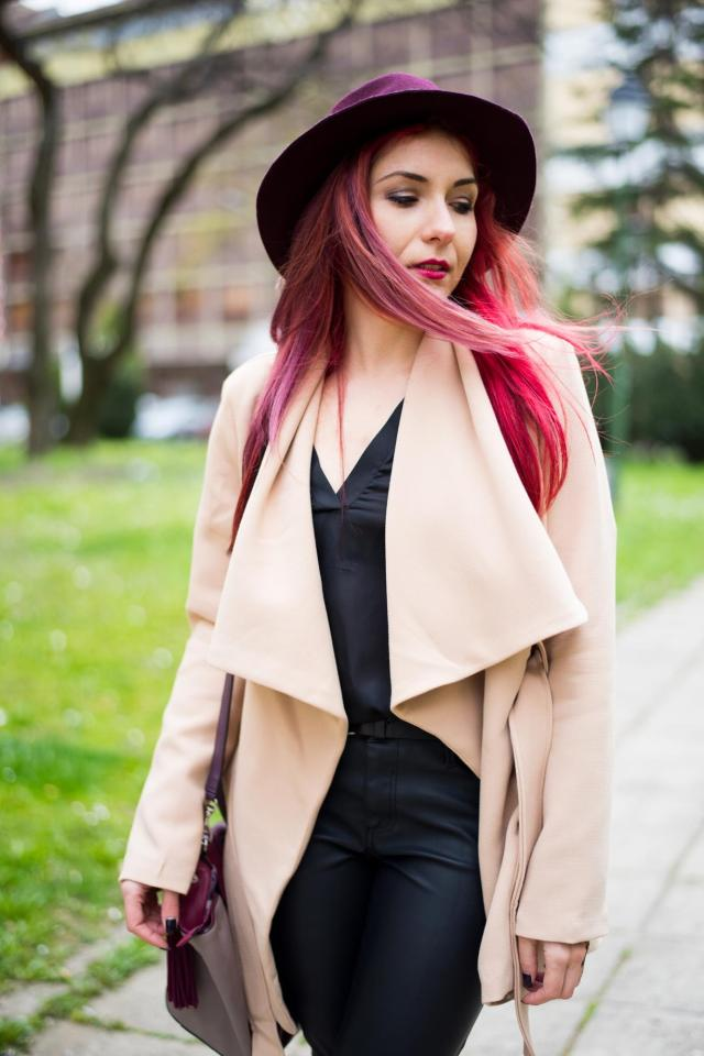 beige coat and leather pants