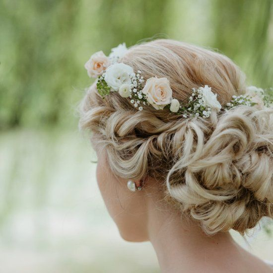 low bun with natural flowers