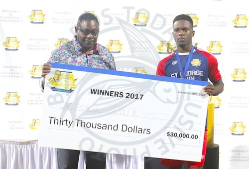 Flashback - then Government Minister Steve Blackett presenting a winners' cheque to St George South's Shakille Belle last December.