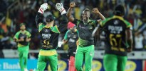 Jamaica Tallawahs captain Andre Russell (second right) celebrating another wicket with his team-mates.