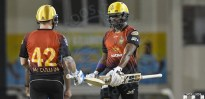 WRECKING CREW - Darren Bravo (right) and Brendon McCullum broke St Lucian hearts and set their tongues wagging last night. (CPL)