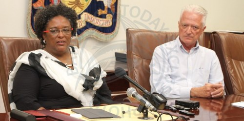 Prime Minister Mia Mottley (left) and owner of the Crane Resort Paul Doyle during today's media conference at Government Headquarters.