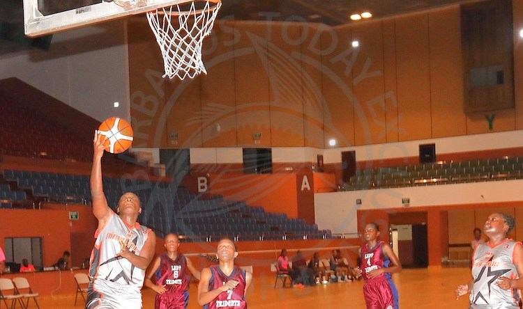 Maria 'Flower' Cumberbatch scores a layup while her captain Sade Clarke (right) looks on.