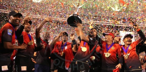 Trinbago Knight Riders celebrate the retention of their Twenty20 crown. Trinidad Prime Minister Dr Keith Rowley (third left) joins in.