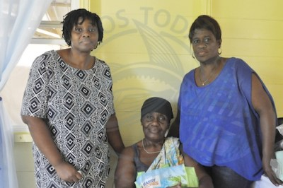 From left, Galeann Waither, Esther Clarke and Andrea Brathwaite standing in their new dwelling.