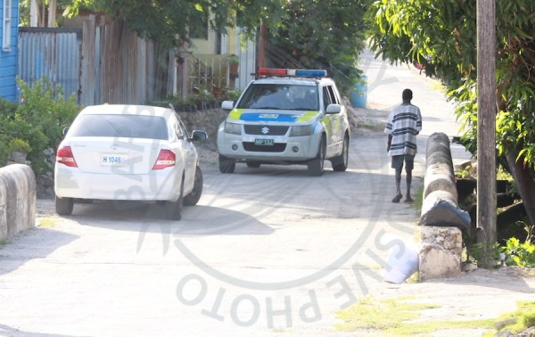 Members of the Royal Barbados Police Force patrolling the area of Crab Hill #2, St Lucy this afternoon following the gruesome death of 40-year-old Dexter Lashley on Sunday.