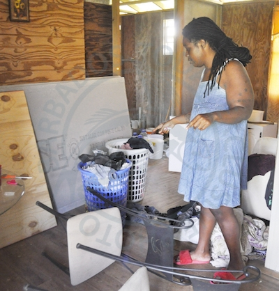 Lisa Emmanuel pointing to the items which were damaged when police came to her house to carry out a search warrant.