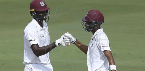 Captain Jason Holder (left) and Roston Chase added 104 to bring some respectability to their score.