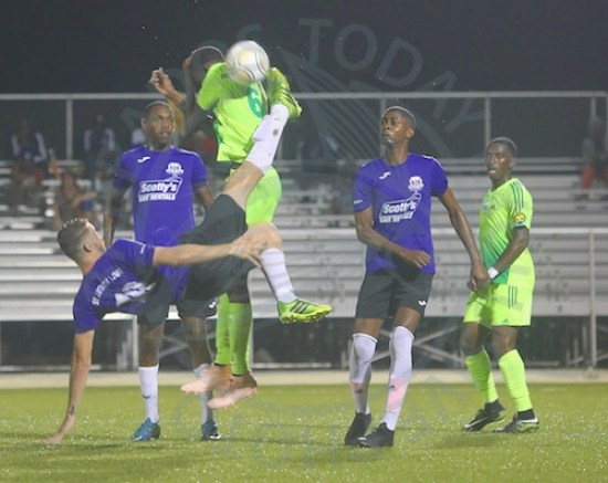 St Andrew Lions' Jefferson Silva scored the opening goal with this lovely bicycle kick against BDFSP. Raheim Sargeant (far right) scored two of the three goals by the soldiers.
