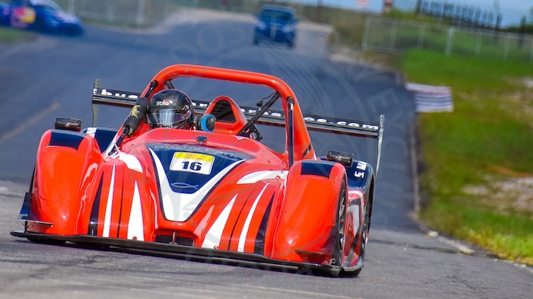 Champion Stuart Maloney piloting his red Suzuki-powered Radical SR3 RS around the South Dakota Circuit in Guyana over the weekend.