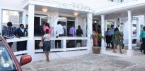 Court Registry workers leaving the meeting which was held with Court Registrar Barbara Cooke-Alleyne.