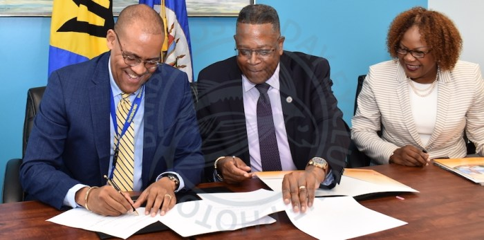 Minister of Tourism and International Transport Kerrie Symmonds (left), and Organisation of American States (OAS) representative Francis McBarnett (centre), signing the OAS funding agreement for tourism projects, as Acting Chief Executive Officer of the Barbados Tourism Product Authority Marsha Alleyne, looks on.
