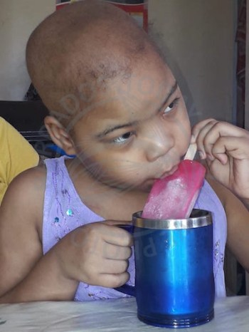 Nine-year-old Azaria Worrell enjoying her ice-lolly.