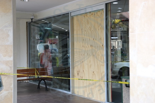 This slab of wood covered the broken store front.