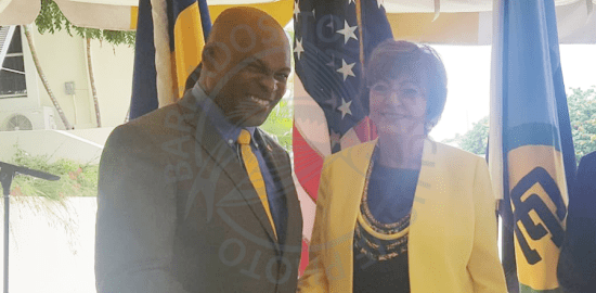 Minister of Home Affairs Edmund Hinkson and United States Ambassador to Barbados and the Eastern Caribbean Linda Taglialatela during today's ceremony.