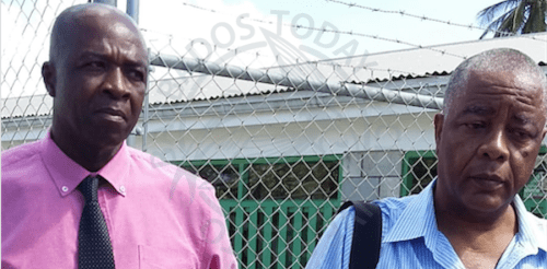 Prison officer Trevor Browne (left) and Senator Caswell Franklyn.