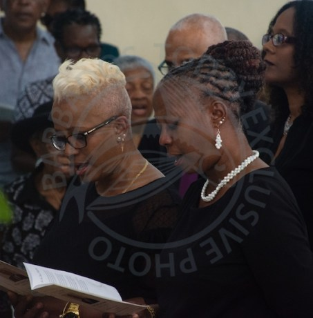 Eveline King-Harper (right), wife of Joey Harper was supported by her sister Lorna King (left) throughout the funeral service.