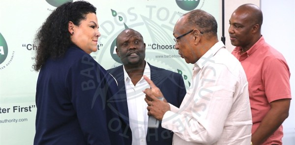 After pledging their donations of new tanks to water scarce communities, representatives of corporate Barbados discuss their continuing support to the Barbados Water Authority with its chairman Leodean Worrell (left). Here we see businessmen Anderson Cherry, (second from left) along with Hallam Nicholls and Paul Bridgeman at the end of a news conference at the BWA headquarters today.
